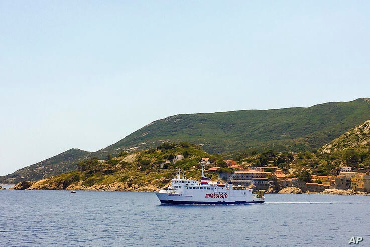 A ferry leaves Giglio island, near the Italian coast of Tuscany, Tuesday, June 23, 2020. In spite of various people with…