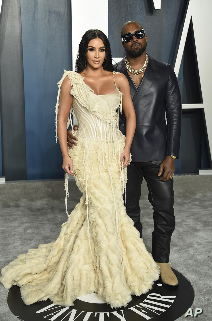 Kim Kardashian, left, and Kanye West arrive at the Vanity Fair Oscar Party on Sunday, Feb. 9, 2020, in Beverly Hills, Calif. …