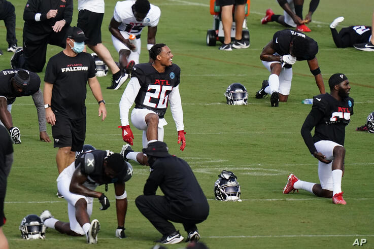 Atlanta Falcons cornerback Isaiah Oliver (26) stretches during an NFL football training camp practice on Wednesday, Aug. 26,…