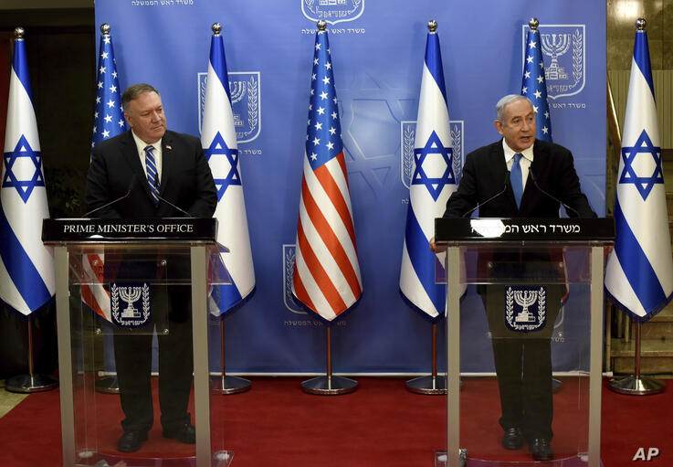U.S. Secretary of State Mike Pompeo, left, and Israeli Prime Minister Benjamin Netanyahu make joint statements to the press…