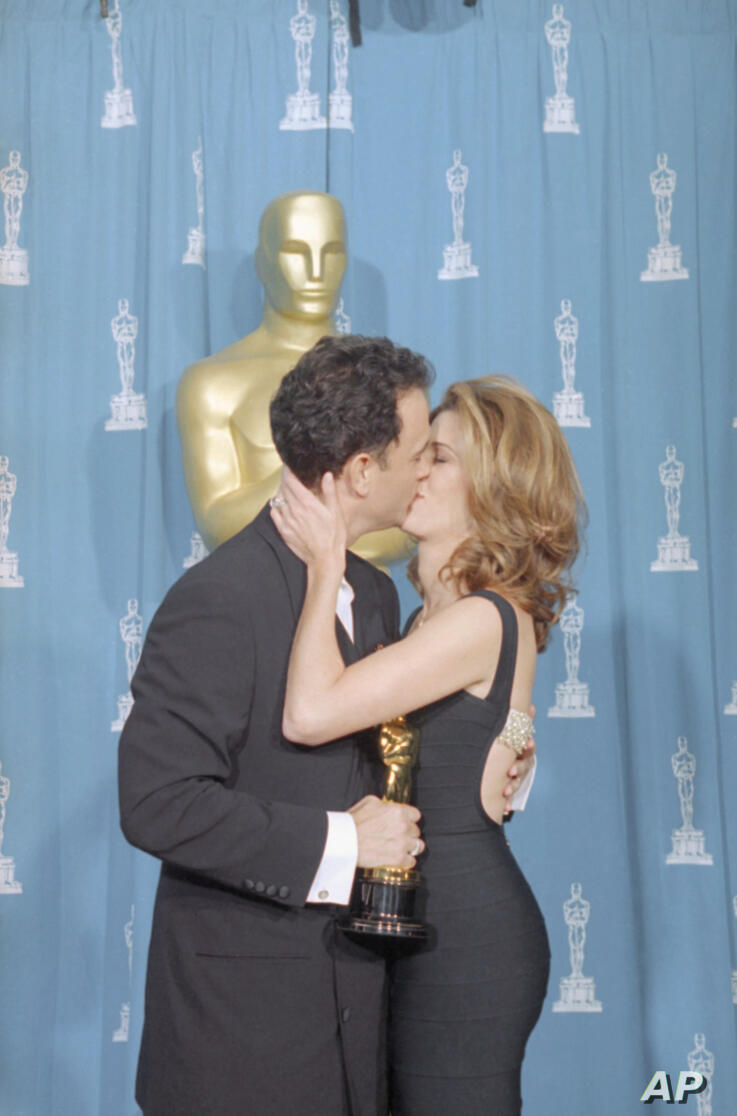 Best Actor Tom Hanks and his wife Rita Wilson exchange a kiss backstage at the 67th Annual Academy Awards after he received his…