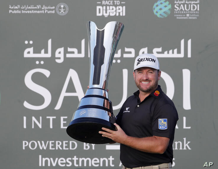 Graeme McDowell from Northern Ireland celebrates with the trophy after he wins the final round of the Saudi International at…