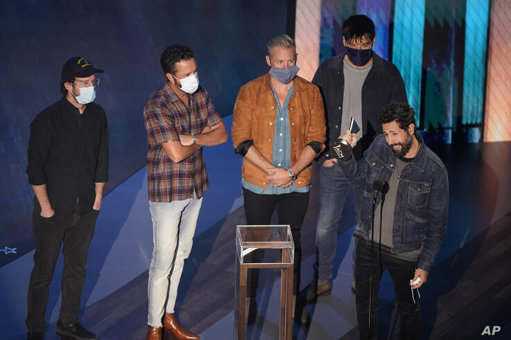 Old Dominion accepts the group of the year award during the 55th annual Academy of Country Music Awards at the Grand Ole Opry…