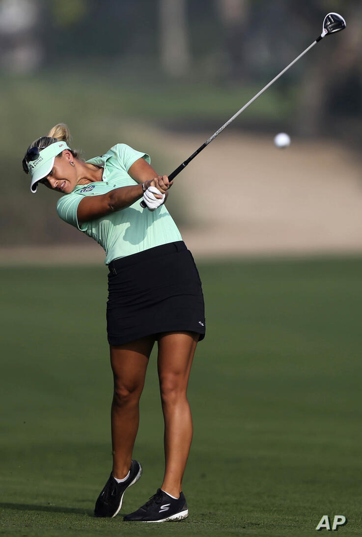 Amy Boulden of Wales plays a shot on the 10th hole during the 1st round of Dubai Ladies Masters golf tournament in Dubai,…