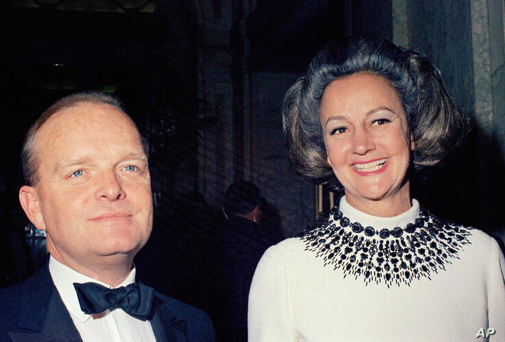 FILE - In this Nov. 28,1966, file photo, writer Truman Capote, left, and guest of honor Katharine Graham arrive at Capote's…