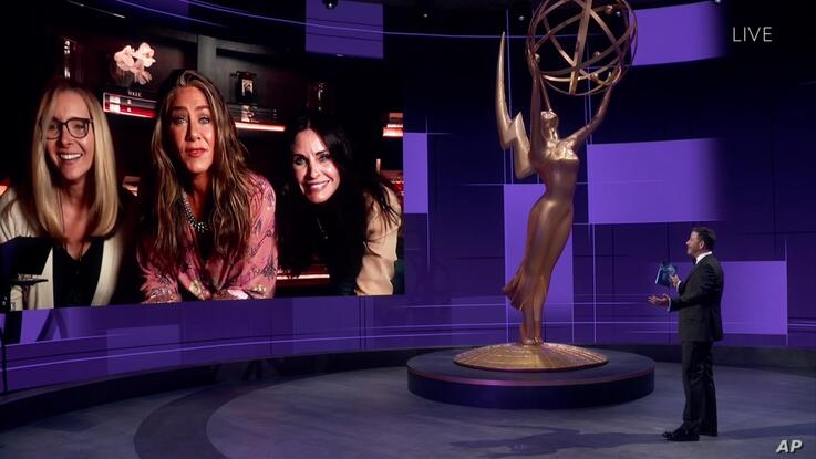 IMAGE DISTRIBUTED FOR THE TELEVISION ACADEMY - Jimmy Kimmel, right, speaks with Lisa Kudrow, Jennifer Aniston and Courteney Cox…