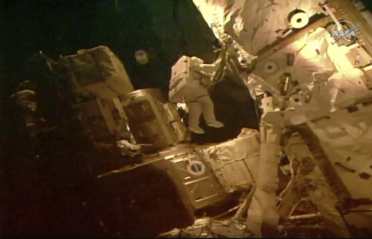 This photo provided by NASA shows astronauts Bob Behnken and Chris Cassidy on a spacewalk outside of the International Space…