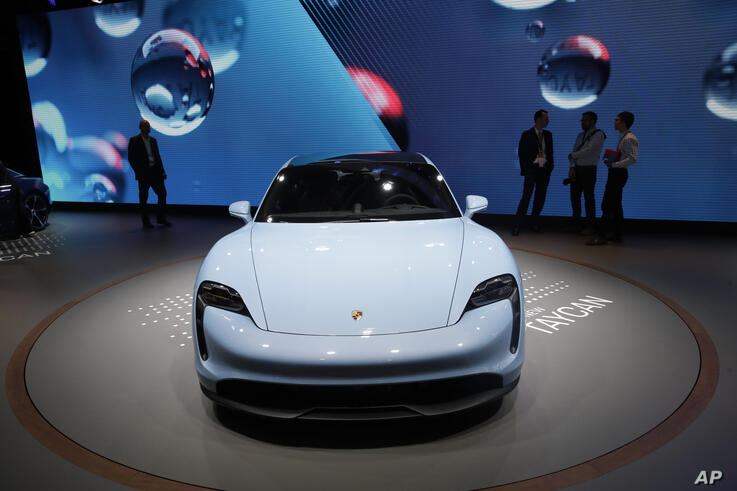The Porsche Taycan 4s electric vehicle is shown at the AutoMobility LA auto show Thursday, Nov. 21, 2019, in Los Angeles. (AP…