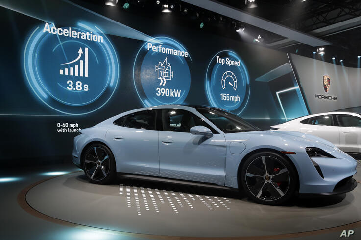 The Porsche Taycan 4S is presented at the AutoMobility LA auto show Wednesday, Nov. 20, 2019, in Los Angeles. (AP Photo/Marcio…