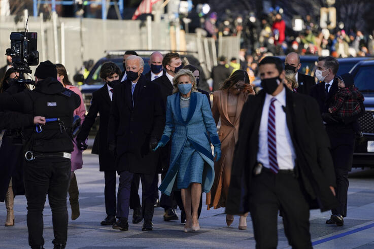 President Joe Biden walks with first lady Jill Biden during the Presidential Escort, part of Inauguration Day ceremonies,…
