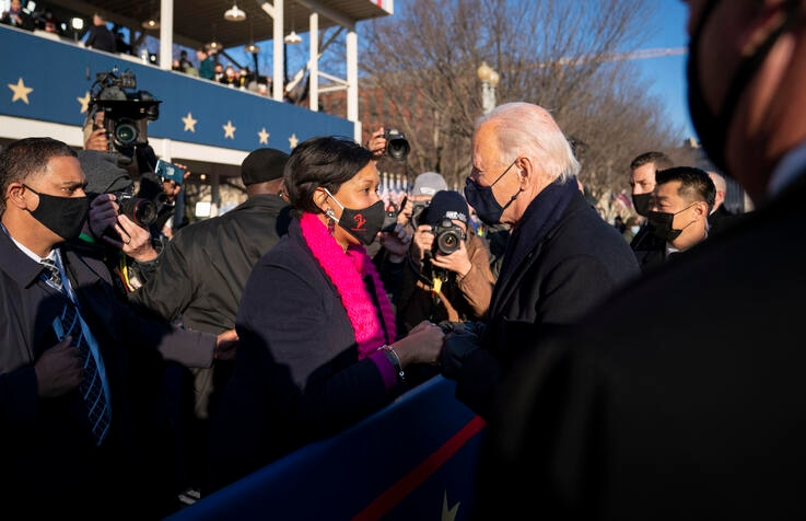 President Joe Biden talks with Washington, D.C. Mayor Muriel Bowser as he and and First Lady Jill Biden walk along Pennsylvania…