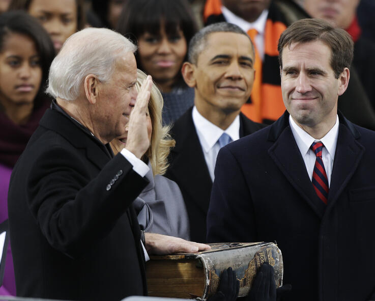 President Barack Obama, center and Beau Biden, Attorney of Deleware, right, watch as his father Joe Biden is sworn in at the…