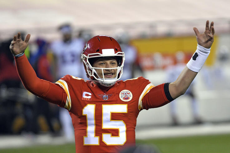 Kansas City Chiefs quarterback Patrick Mahomes celebrates at the end of the AFC championship NFL football game against the…