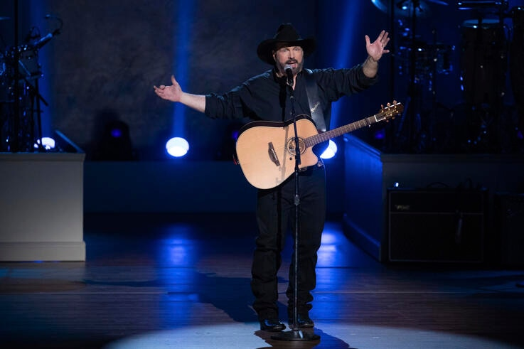 FILE - In this March 4, 2020, file photo, Garth Brooks performs on stage during the 2020 Gershwin Prize Honoree's Tribute…