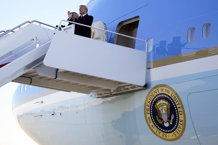 President Donald Trump and first lady Melania Trump board Air Force One at Andrews Air Force Base, Md., Wednesday, Jan. 20,…