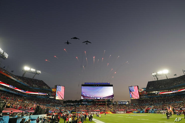 Planes fly over the stadium before the NFL Super Bowl 55 football game between the Kansas City Chiefs and Tampa Bay Buccaneers,…