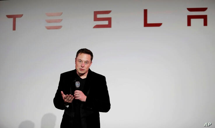 FILE - In this Sept. 29, 2015, file photo, Elon Musk, CEO of Tesla Motors Inc., talks about the Model X car at the company's…
