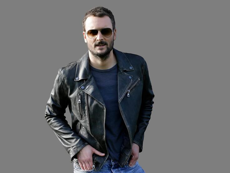 Eric Church headshot, country music singer, graphic element on gray