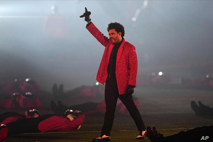 The Weeknd performs during halftime of the NFL Super Bowl 55 football game between during the halftime show of the NFL Super…
