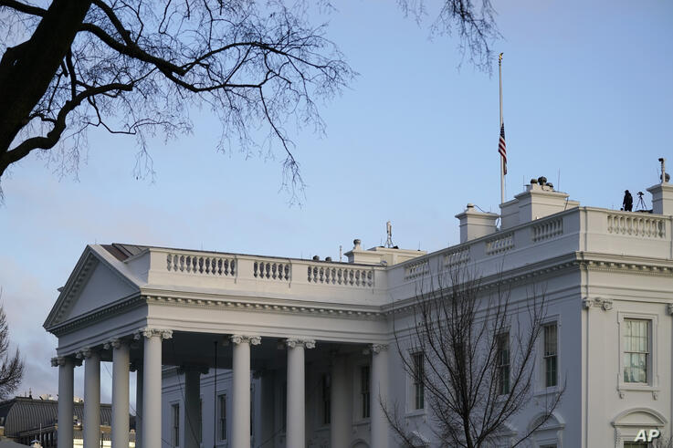 The flags at the White House fly at half-staff to honor the 500,000 Americans that died from COVID-19, Monday, Feb. 22, 2021,…
