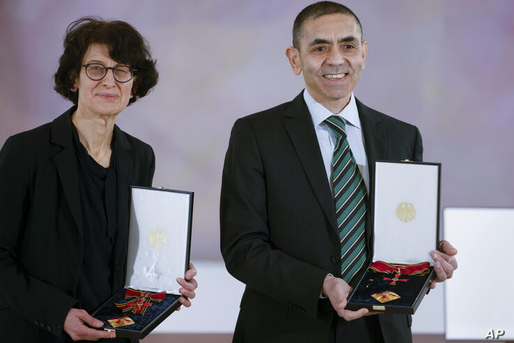 Ozlem Tureci, left, and her husband Ugur Sahin, both scientists and founders of BioNTech, pose with their orders after they…