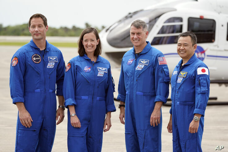 SpaceX Crew 2 members, from left, European Space Agency astronaut Thomas Pesquet, NASA astronauts Megan McArthur and Shane…