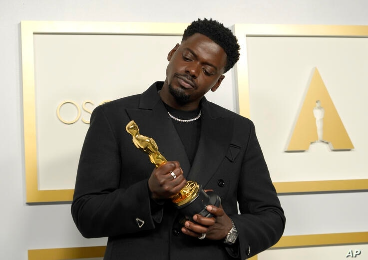 """Daniel Kaluuya, winner of the award for best actor in a supporting role for """"Judas and the Black Messiah,"""" poses in the press…"""
