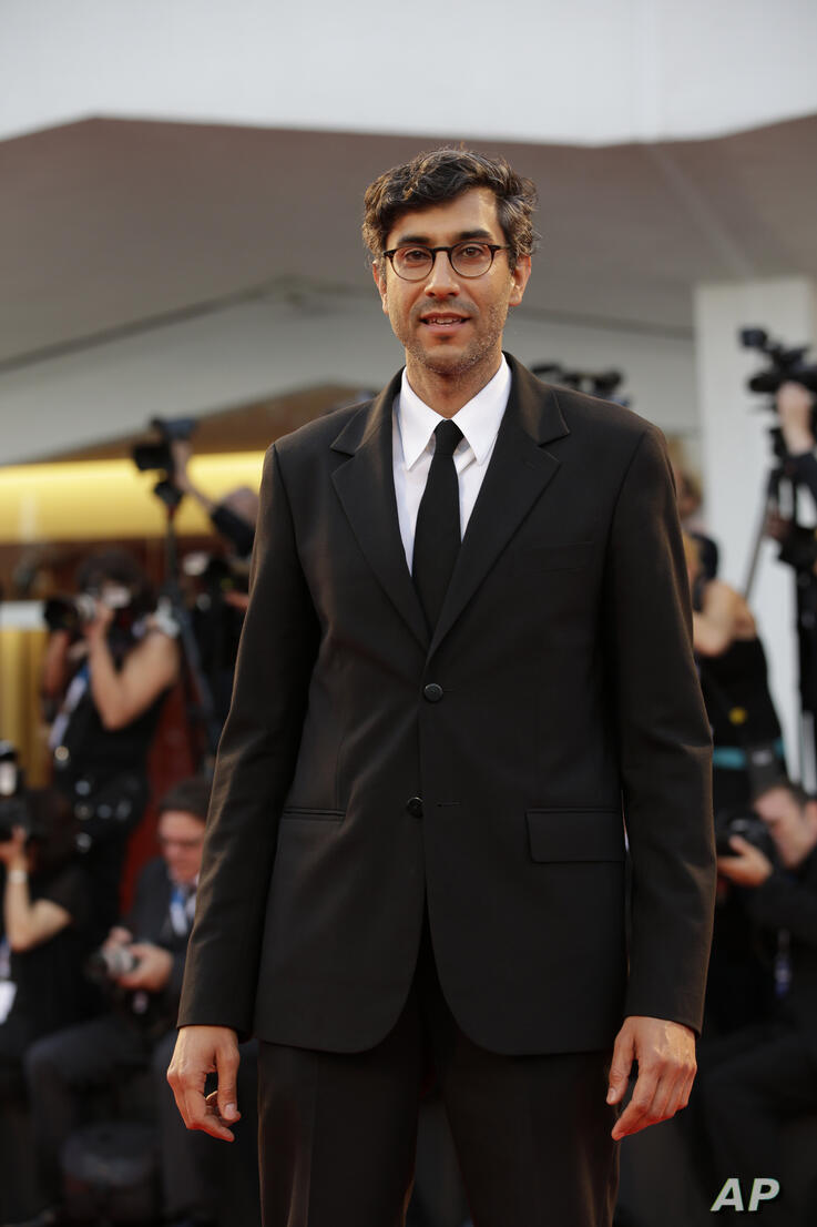Director Ramin Bahrani arrives for the premier of the movie 99 Homes at the71st edition of the Venice Film Festival in Venice,…