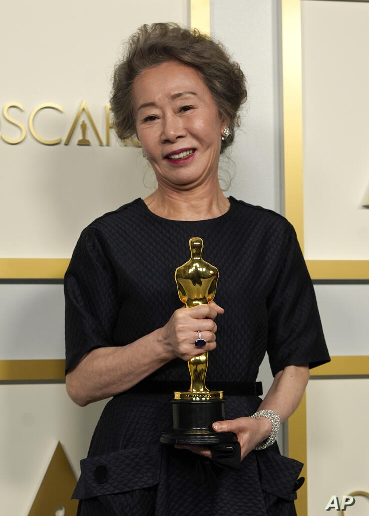 """Yuh-Jung Youn, winner of the award for best actress in a supporting role for """"Minari,"""" poses in the press room at the Oscars on…"""