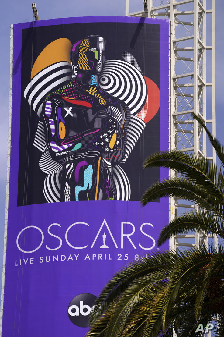 A sign advertising this year's Oscars ceremony is pictured near the Dolby Theatre, Thursday, April 15, 2021, in Los Angeles…