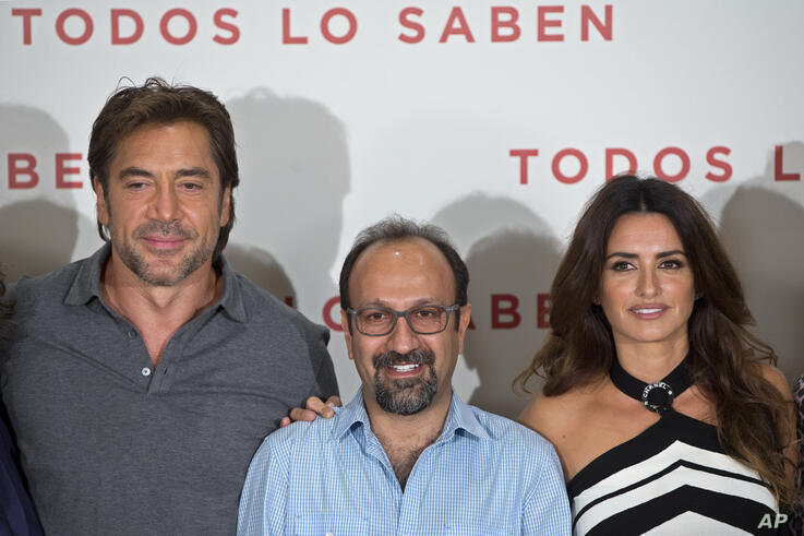 Director Asghar Farhadi, center, poses with actors Javier Bardem, left, and Penelope Cruz during a photocall to present the…