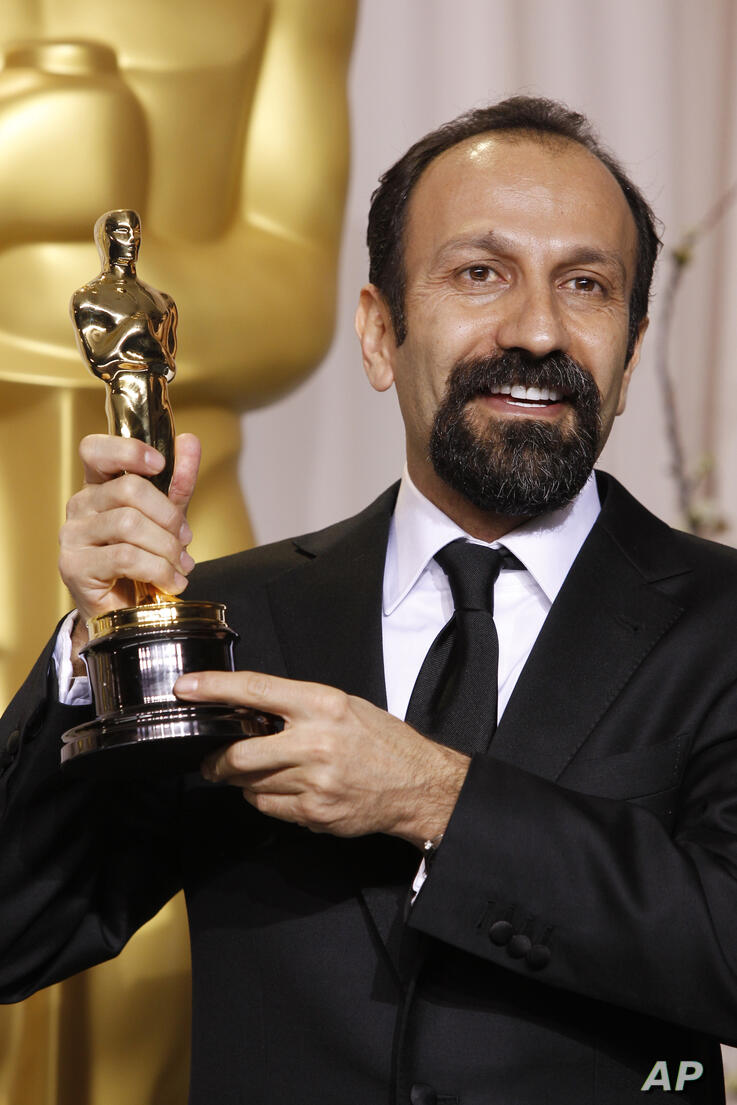 FILE - In this Sunday, Feb. 26, 2012 file photo, Asghar Farhadi, of Iran, poses with the Oscar for best foreign language film…