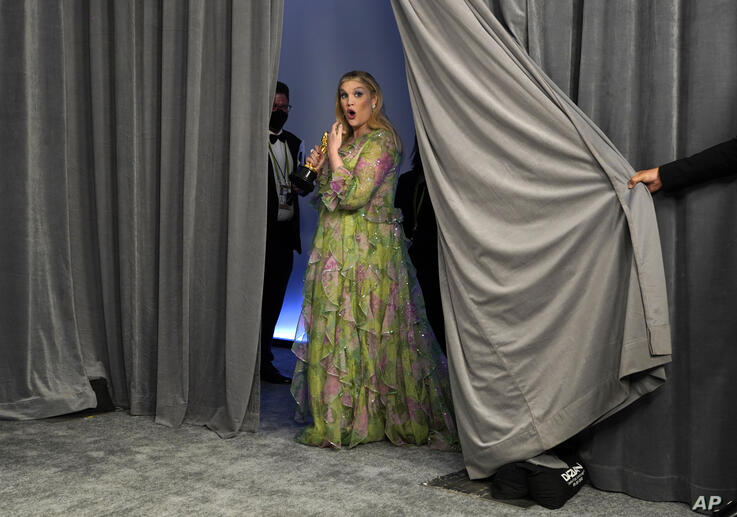 """Emerald Fennell, winner of the award for best original screenplay for """"Promising Young Woman,"""" poses in the press room at the…"""