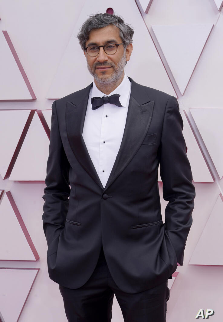 Ramin Bahrani arrives at the Oscars on Sunday, April 25, 2021, at Union Station in Los Angeles. (AP Photo/Chris Pizzello, Pool)