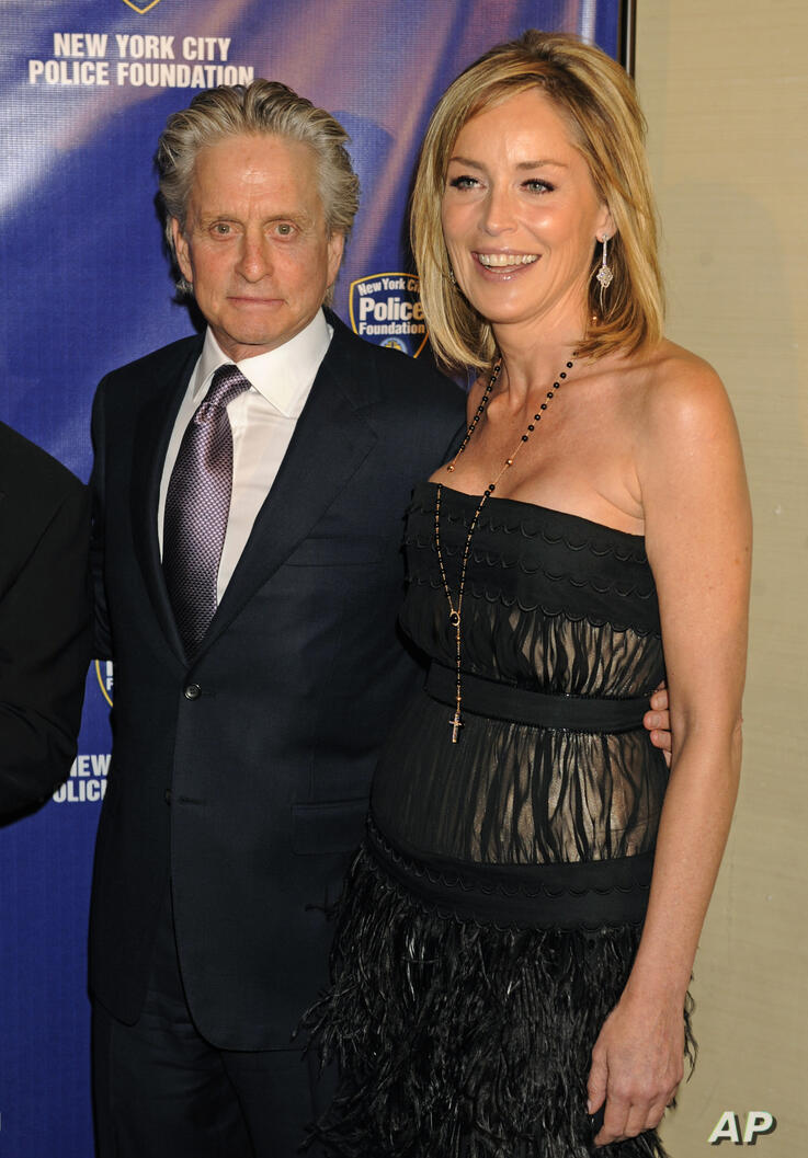 Michael Douglas, left, and Sharon Stone pose for photos upon arriving for the 32nd annual New York City Police Foundation Gala,…