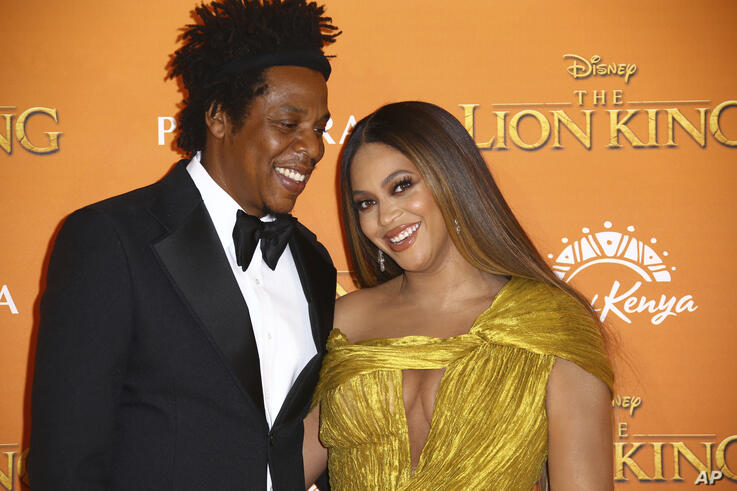 Singers Jay-Z, left, and Beyonce pose for photographers upon arrival at the 'Lion King' European premiere in central London,…