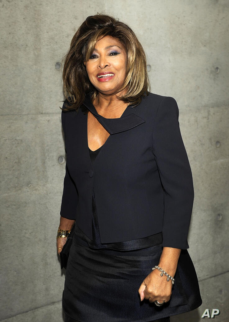 Pop star Tina Turner poses prior to attending the Giorgio Armani Fall/Winter 2011 collection presented in Milan, Italy, Monday,…