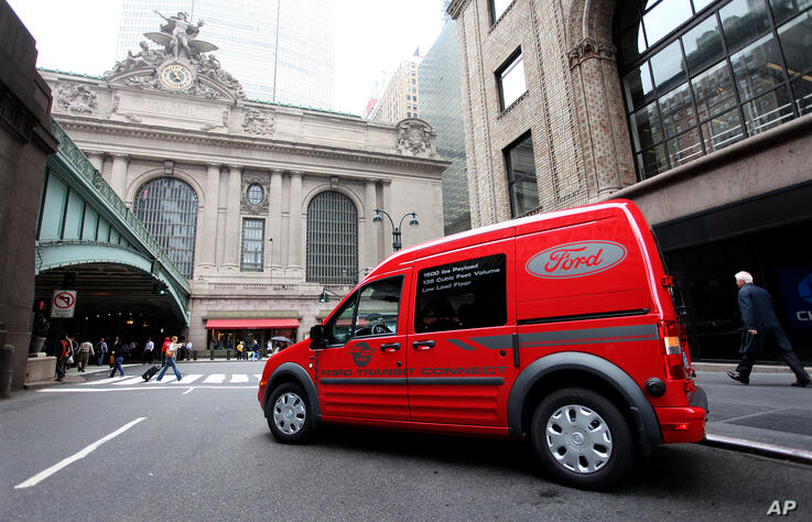 FILE - In this Thursday, May 28, 2009, file photo a 2010 Ford Transit Connect sits near Grand Central Terminal in New York…
