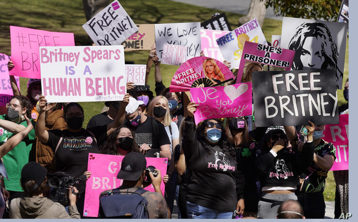 Britney Spears fans hold signs outside a court hearing concerning the pop singer's conservatorship at the Stanley Mosk…