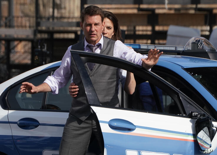 """FILE - Actors Tom Cruise and Hayley Atwell appear during the filming of the movie """"Mission: Impossible 7"""" in Rome on Oct. 13,…"""