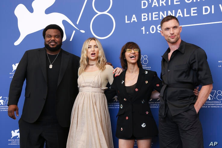 Ed Skrein, from right, Ana Lily Amirpour, Kate Hudson and Craig Robinson pose for photographers at the photo call for the film …
