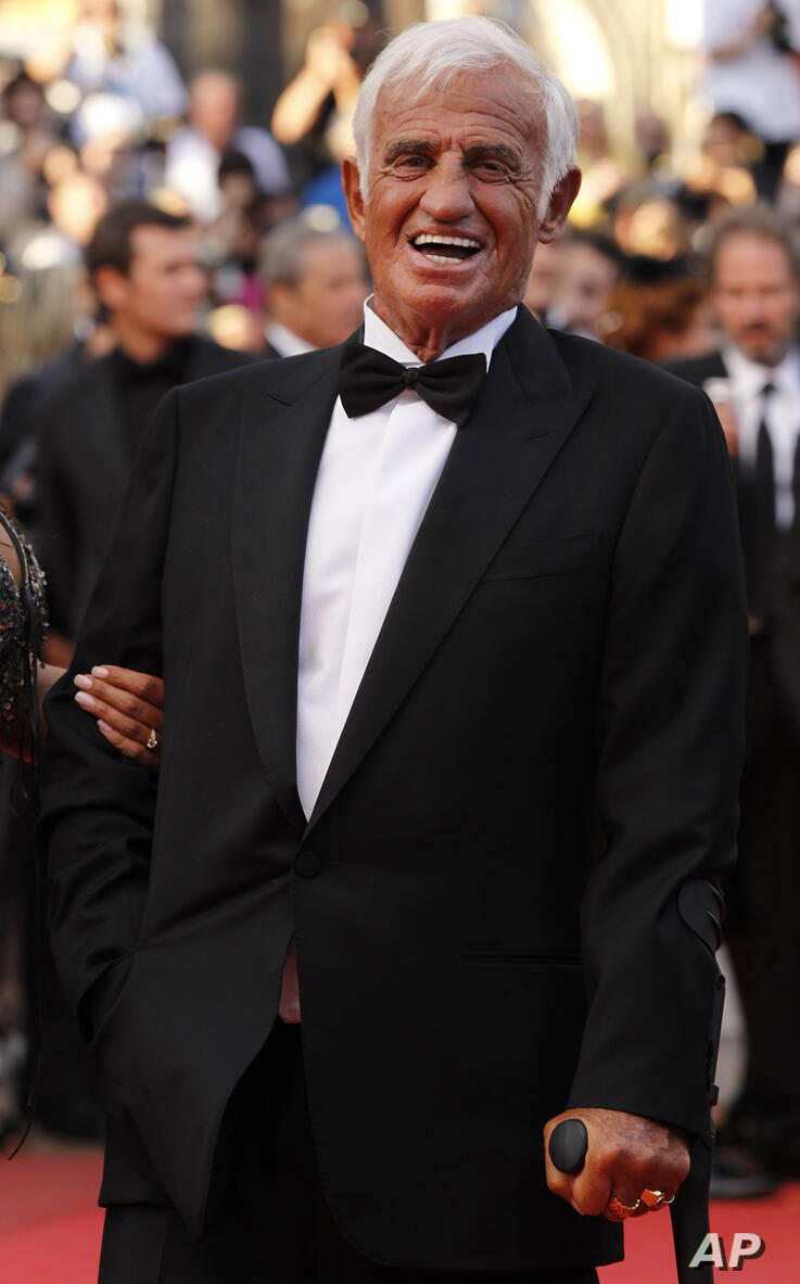 Actor Jean-Paul Belmondo arrives to be honoured for his career in the film industry during the 64th international film festival…