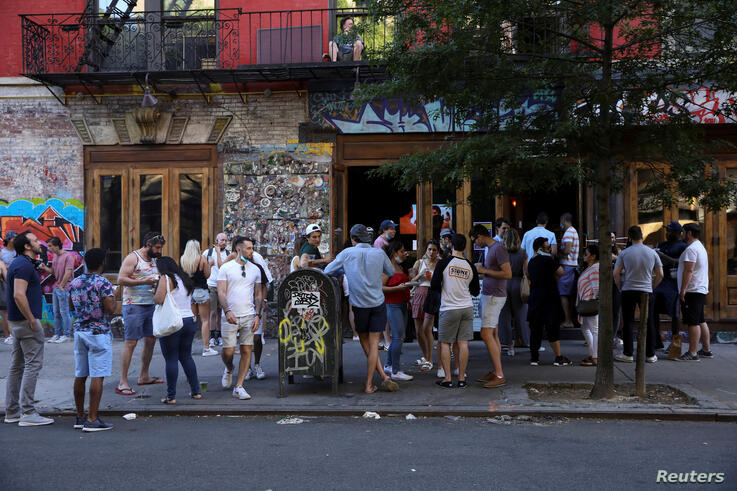 People drink outside a bar during the reopening phase following the coronavirus disease (COVID-19) outbreak
