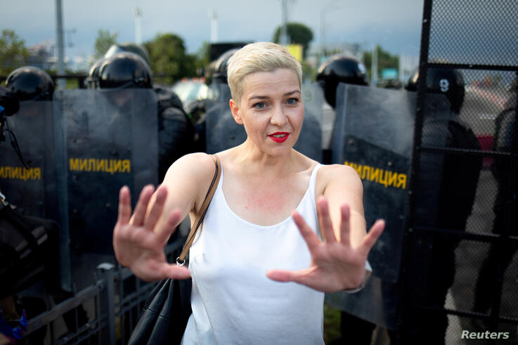 FILE PHOTO: Belarusian opposition politician Maria Kolesnikova gestures in front of law enforcement officers during a rally in Minsk