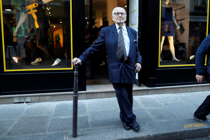 """FILE PHOTO: French fashion designer Pierre Cardin poses in front of his store next to his museum called """"Past-Present-Future"""" in Paris"""