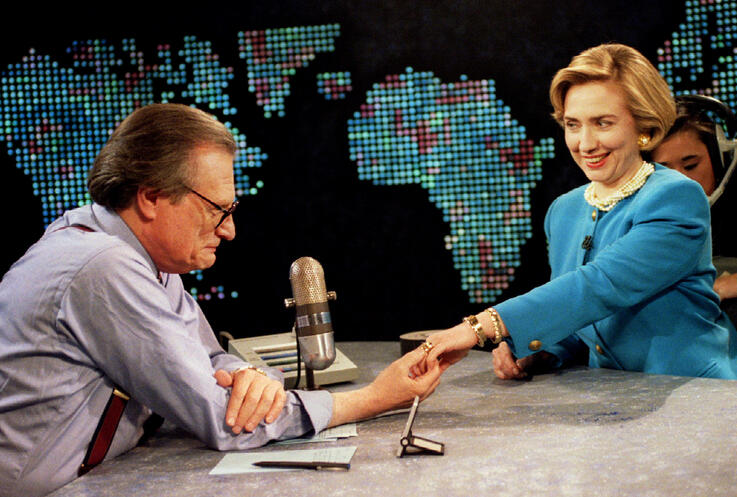 FILE PHOTO: Sporting a new hairdo, first Lady Hillary Rodham Clinton shows her wedding ring to CNN's Larry King,..