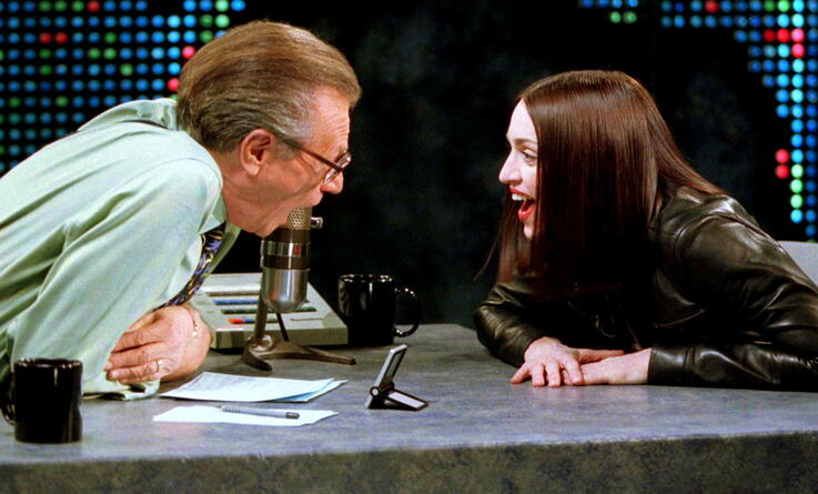 """FILE PHOTO: Singer and actress Madonna (R) shares a laugh with Larry King on the set of the CNN talk show """"Larry King Live\"""