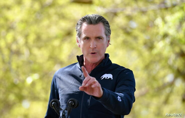 FILE PHOTO: California Governor Gavin Newsom speaks during a visit by U.S. First Lady Jill Biden, at The Forty Acres, the first headquarters of the United Farm Workers labor union, in Delano, California