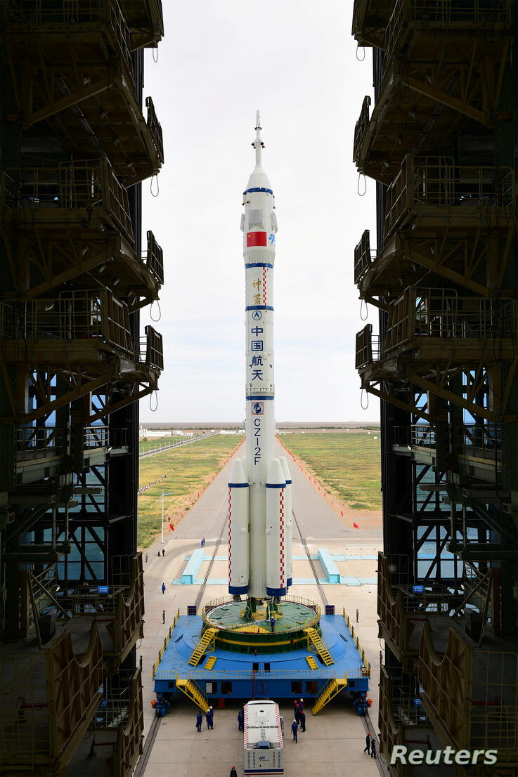 The Long March-2F Y12 rocket carrying the Shenzhou-12 spacecraft is transferred to the launch pad at Jiuquan Satellite Launch Center
