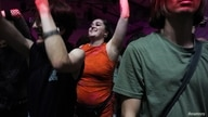 """A reveller dances during the """"00:01"""" event organised by Egyptian Elbows at Oval Space nightclub, as England lifted most…"""